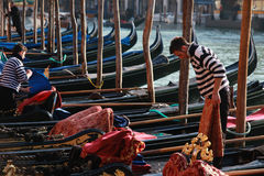 Gondoliers preparing their gondolas on the Grand Canal in Venice, Italy Stock Photos