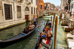 Gondoliers with rourists at canal in Venice Royalty Free Stock Images