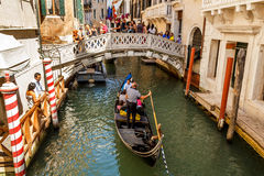 Gondoliers with rourists at canal in Venice Stock Photo
