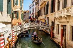 Gondoliers with rourists at canal in Venice Stock Image