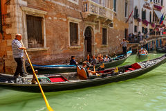 Gondoliers with rourists at canal in Venice Stock Photos