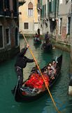 Gondoliers taking tourists on Venice canals Stock Images