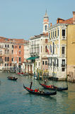 Gondoliers taking tourists on Venice canals,Italy stock photo