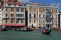 Gondoliers and their gondolas Stock Photos