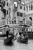 Gondoliers and tourists in gondolas stock photo