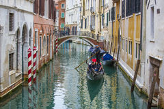 Gondoliers with tourists on gondolas Royalty Free Stock Images