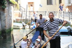 Gondoliers and Tourists in the Grand Canal Stock Photography