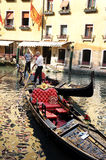 Gondoliers in a venetian canal Stock Photo