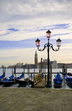 Gondolla dock in Venice, Italy. A gondola dock and typical light post - symbols of Venice, Italy Stock Images