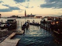 Gondols. Gondola, sunset and church of san giorgio maggiore Stock Images