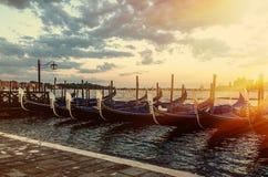 Gondols. Many gondols in sunset light with the sea on background Royalty Free Stock Photos