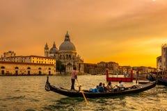 The Gondora casting off the pier, Venice, Italy. royalty free stock photo