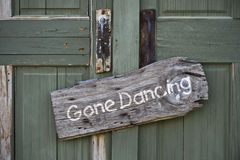 Gone Dancing. Gone dancing sign on old green doors royalty free stock image