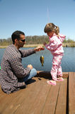 Gone fishing. A father and daughter go fishing together stock photography