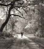 Gone fishing. A joyful fisherwoman on a country road in the Deep South of the U.S Stock Photo