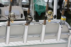 Gone fishing. Picture of a line of fishing poles on the rear of a fishing boat in Florida Stock Photo