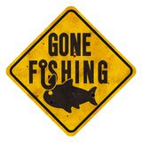 Gone Fishing Sign Grunge with Hook and Fish Metal Street Sign Style. Gone Fishing Sign Logo Art with Fish and Hook on a metal street sign background yield yellow royalty free stock image