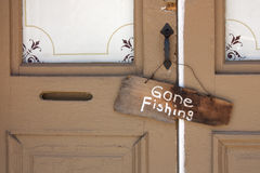 Gone Fishing Sign on old Country Store front door. This Gone Fishing sign hanging on the front door of an old country store tells a story of the simple life of a royalty free stock images