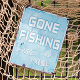 Gone fishing sign. Simple sign on a fishingnet saying gone fishing Stock Photography