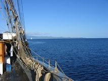 Gone sailing. View over the side from a tall-ship sailing boat in the south pacific on a peaceful day Royalty Free Stock Photo