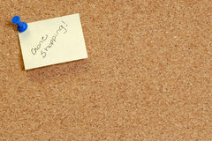 Gone shopping. Cork board with note saying gone shopping Stock Images
