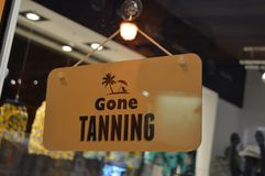 Gone tanning door closed sign stock photography