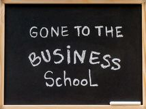 Gone to the business school message written with white chalk on wooden frame blackboard Royalty Free Stock Images