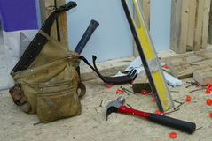 Gone to Lunch- Horizontal. Construction worker's tool belt and tools scattered on the sub floor of a new house construction site Royalty Free Stock Images