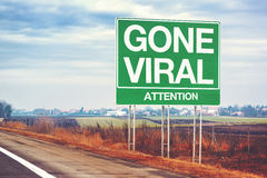 Gone viral concept with road sign. Retro toned Stock Image