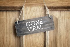 Gone viral sign on office door concept for internet marketing a Stock Photo