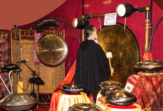 Gong Player at the Festival of the Orient in Rome Italy. The Festival of the Orient was held at the Exhibition Centre near Rome Airport at Fumincino on the Stock Image