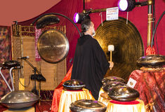 Gong Player at the Festival of the Orient in Rome Italy. The Festival of the Orient was held at the Exhibition Centre near Rome Airport at Fumincino on the Stock Images