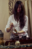 Gongfu tea ceremony. A young girl holds a Chinese tea ceremony stock photography