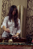 Gongfu tea ceremony. A young girl holds a Chinese tea ceremony royalty free stock photos