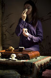 Gongfu tea ceremony. A young girl holds a Chinese tea ceremony stock image