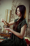 Gongfu tea ceremony. A young girl holds a Chinese tea ceremony royalty free stock photo