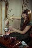 Gongfu tea ceremony. A young girl holds a Chinese tea ceremony stock photo