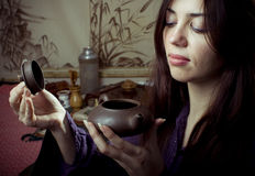 Gongfu tea ceremony. A young girl holds a Chinese tea ceremony stock photos
