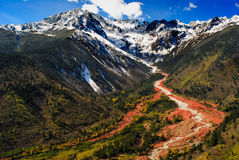Gongga glacier. The red stone beach of Mount Gongga in Hailuogou (Conch Gully) National Glacier Forest Park in China. Mount Gongga is high 7556m, is the highest Stock Photography