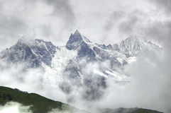 Gongga Snow. To overlook Gongga Snow mountain far in the clouds royalty free stock photography