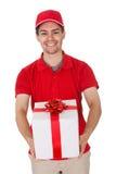 Goniec dostarcza dekoracyjnego prezent obrazy royalty free