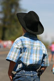 Gonna be a cowboy. A young cowboy stands watching the local rodeo parade Royalty Free Stock Photo