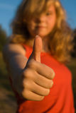Good. Gesture approval. Teenager out of focus Stock Image