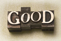 Good. The word Good done in old letterpress type on a light green fabric background royalty free stock photography