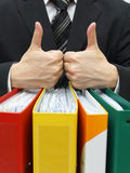 Good accounting or business service with thumb up on binders Stock Photography