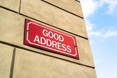 Good Address. Signboard on the wall of house - street in popular neigborhood and residential location. City, towns, urbanic destination and positivity Stock Photography