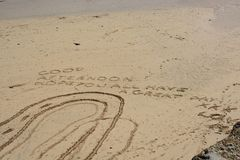 Good Afternoon Message in the sand. Good Afternoon Message written in the sand on beach at Saint Ives, Cornwall, England royalty free stock images