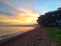 Good afternoon from the Philippines. This is the view when you are walking along the beach in my hometown stock photo