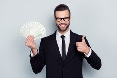 Good, agree, trust, perfect, join, cool, symbol, benefit, expensive concept. Cheerful expert confident agent investor banker. Making thumb-up holding fan of royalty free stock photos