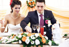 Good appetite. Husband taking food on wedding Royalty Free Stock Image